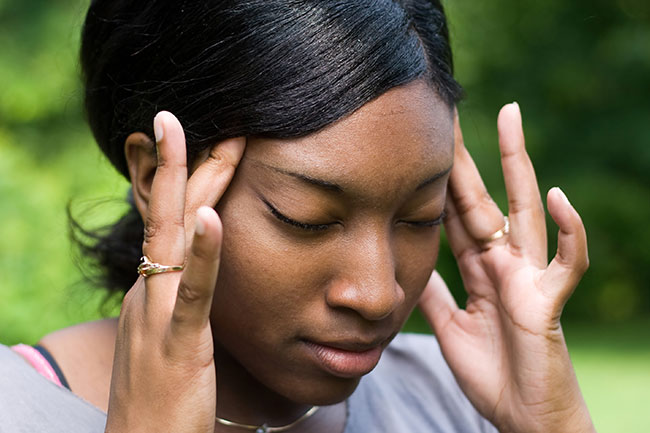 Women rubbing her head stressed out.