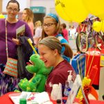 Girl laughing at Wellsville event