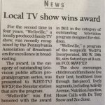 "News article with headline reading ""Local TV show wins award."""