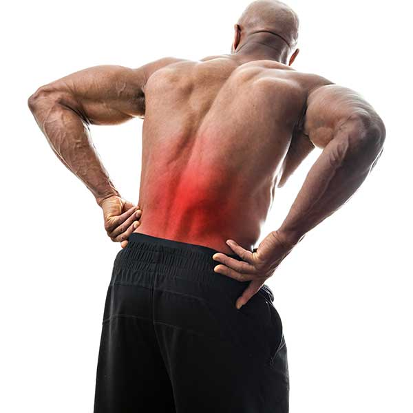 Man, in pain, reaching for his back