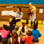 Wellsville goes to school volunteers and students.
