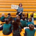Teacher at Blessed Sacrament School reading to students
